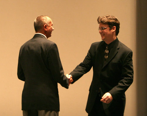 Barry Morrow welcomes Lane Wyrick on stage at World Premiere